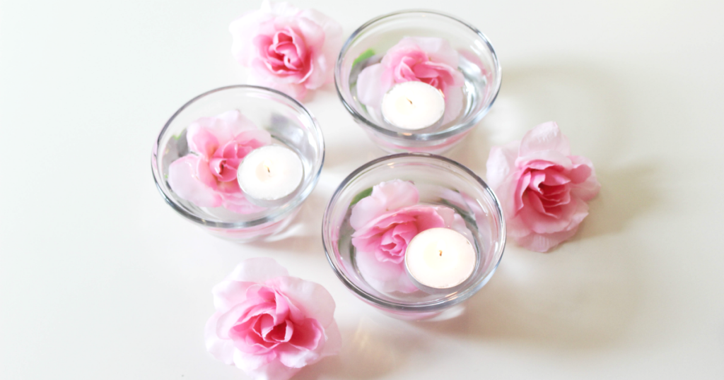 Spring centerpiece with candles and flowers